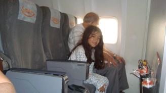 De pijama, no avião.