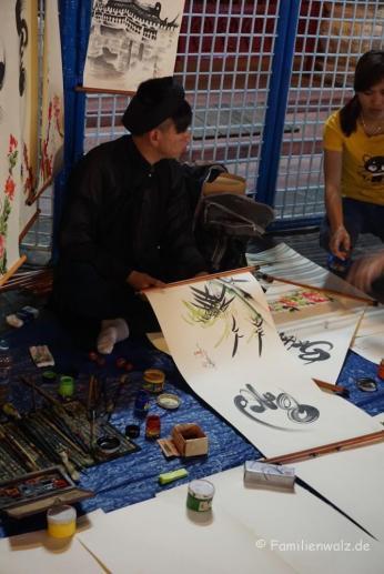 Straßenkünstler in Hoi An