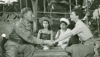 Some Enchanted Evening song lyrics (1949) from South Pacific Lyrics to 'Some Enchanted Evening' - a show tune from the 1949 Rodgers and Hammerstein musical 'South Pacific'. In the show, it is sung as a solo by Emile de Becque, the French plantation owner, who falls in love with the American navy nurse Nellie Forbush. In this song he sings of seizing the moment so that it won't slip away.