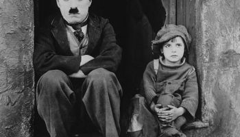 Charlie Chaplin and Jackie Coogan in an iconic photo from The Kid