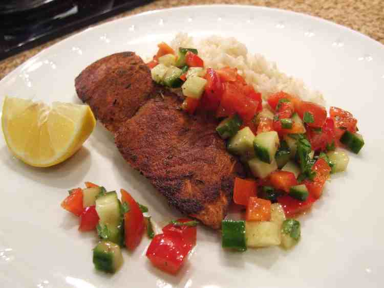 Spicy pan-fried salmon with rice and chopped salad