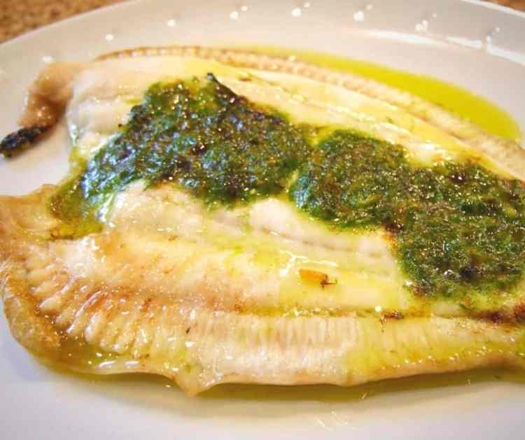 grilled plaice with orange herb butter.