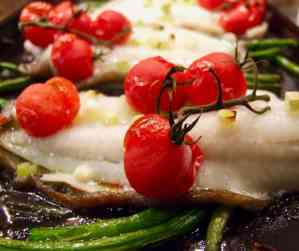 lemon sole tray bake with cherry tomatoes and green beans.
