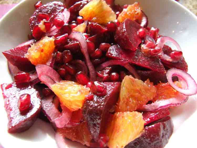 A nutritious and simple salad. Earthy beets are paired with zesty orange and the fragrant sharp-sweet crunch of pomegranate seeds. Beautiful and delicious!
