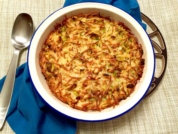 Rich with caramelised leeks, onions & thyme, this gorgeous potato kugel is crispy on the outside, meltingly soft inside, & delicious all the way through. #kugel #Jewishfood #sidedish
