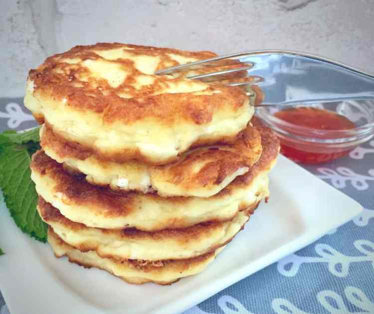 feta cheese pancakes - Light and fluffy cheese pancakes made with ricotta and feta are deliciously savoury. Perfect for Chanukah or as a tasty brunch treat at any time!