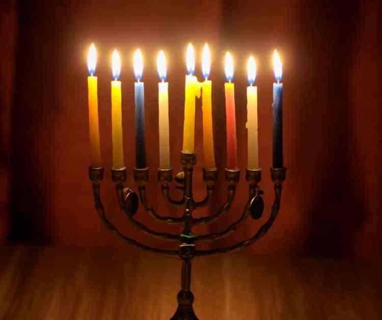 Chanukah menorah with candles.