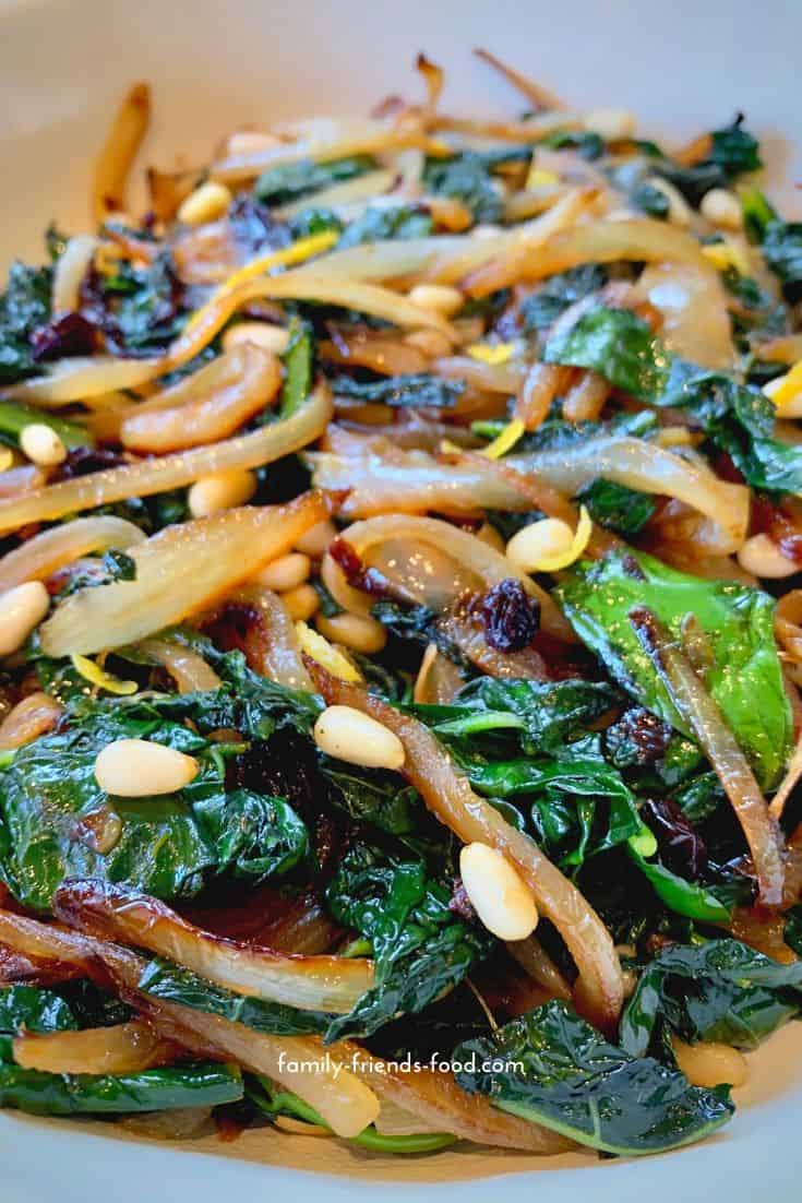 Savoury, salty, sweet and zesty, this Sicilian-style kale has it all! Use cavolo nero or substitute your favourite greens to make this delicious dish.