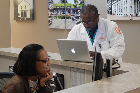 Doctor and nurse at a workstation