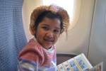 On the plane, she always reads the safety card :)