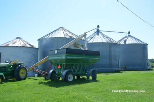 4 grain bins and tractor with wagon