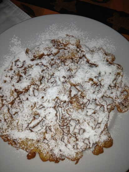 Powdered sugar covered funnel cake