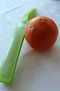 Kitchen IQ zester and an orange