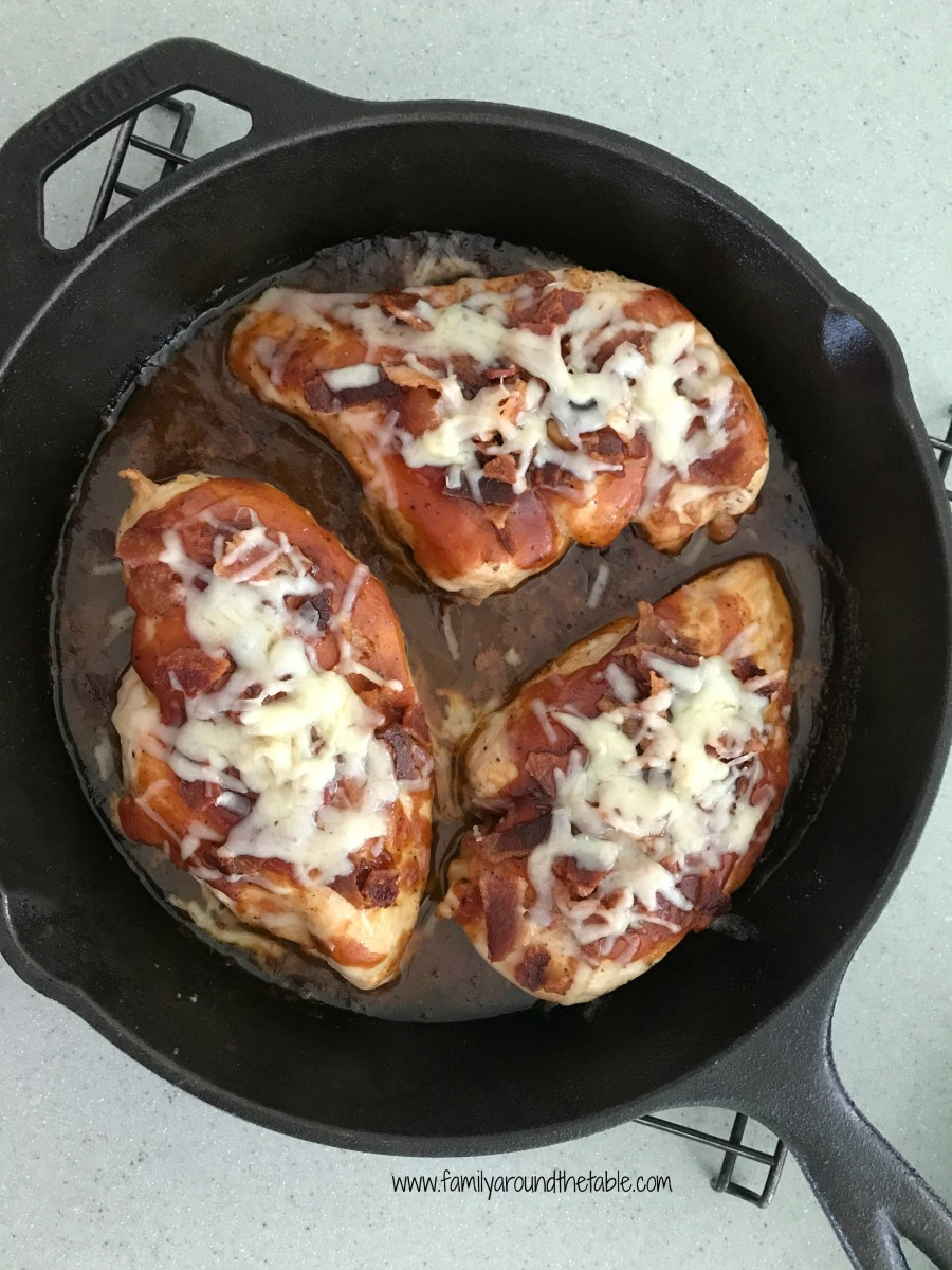 Barbecue Bacon Cheddar Chicken in a cast iron skillet.
