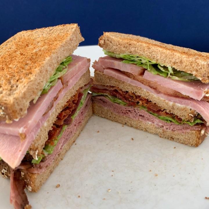 A club sandwich cut in half.