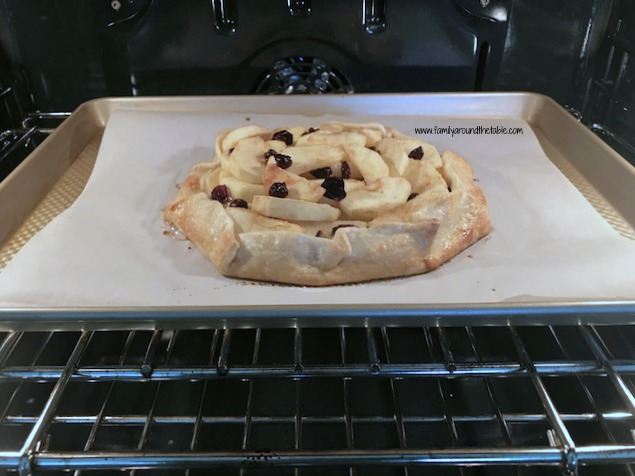 Apple Cranberry Galette baking away!