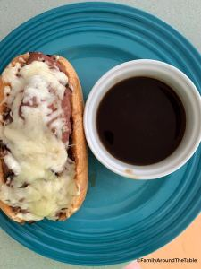 Overhead photo of a French Dip sandwich with dipping sauce.