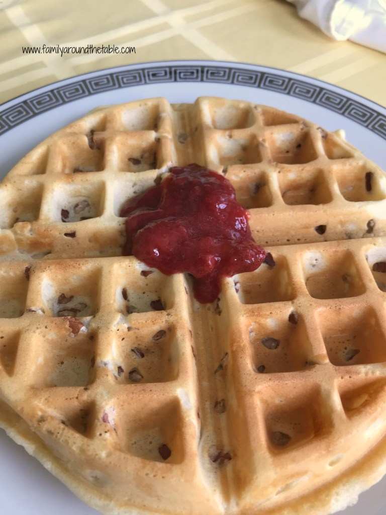 Pecan waffles with strawberry sauce.