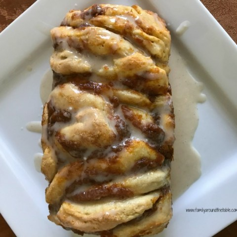 Easy pumpkin spice pull-apart bread with cinnamon vanilla glaze is perfect for breakfast or a fun dessert.