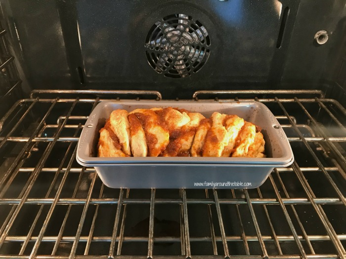 Easy pumpkin spice pull-apart bread with cinnamon vanilla glaze in the oven.