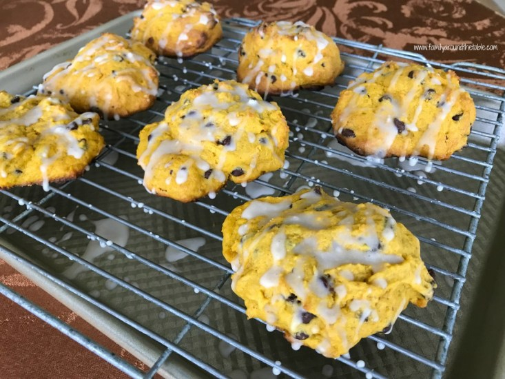 Glazed Pumpkin Chocolate Chip Scones and a cup of coffee are a perfect way to start the day.