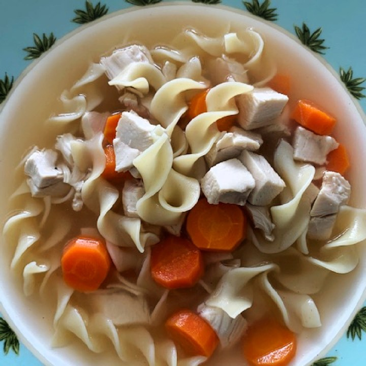 Overhead photo of chicken noodle soup in a bowl.