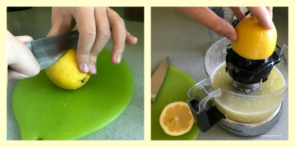 Cutting and juicing lemons for blueberry lemonade.