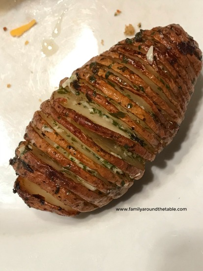 Herbed hassleback potatoes are and easy side dish for any entree.