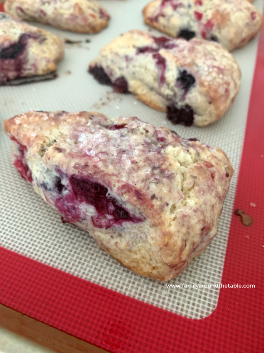 Mixed berry scone on a baking sheet.