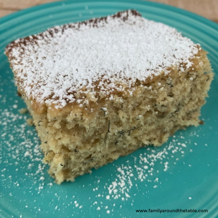 A square slice of Grandma's banana cake on a plate.