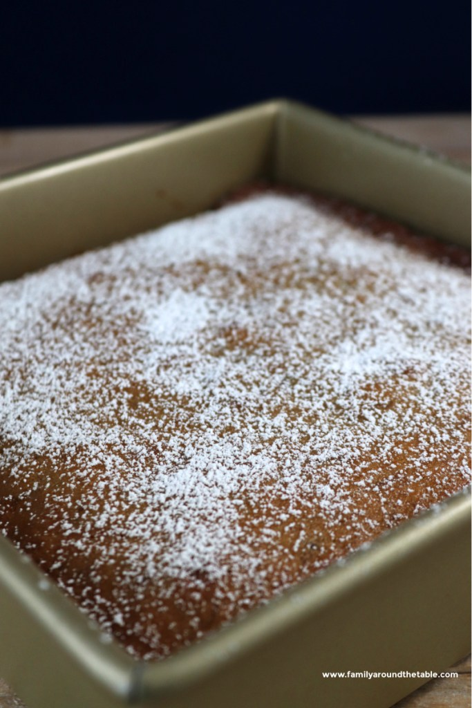 Whole old fashioned crumb cake in a baking pan.