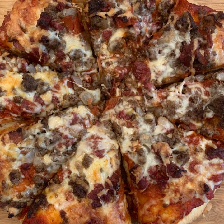 Overhead photo of meat lovers skillet pizza.
