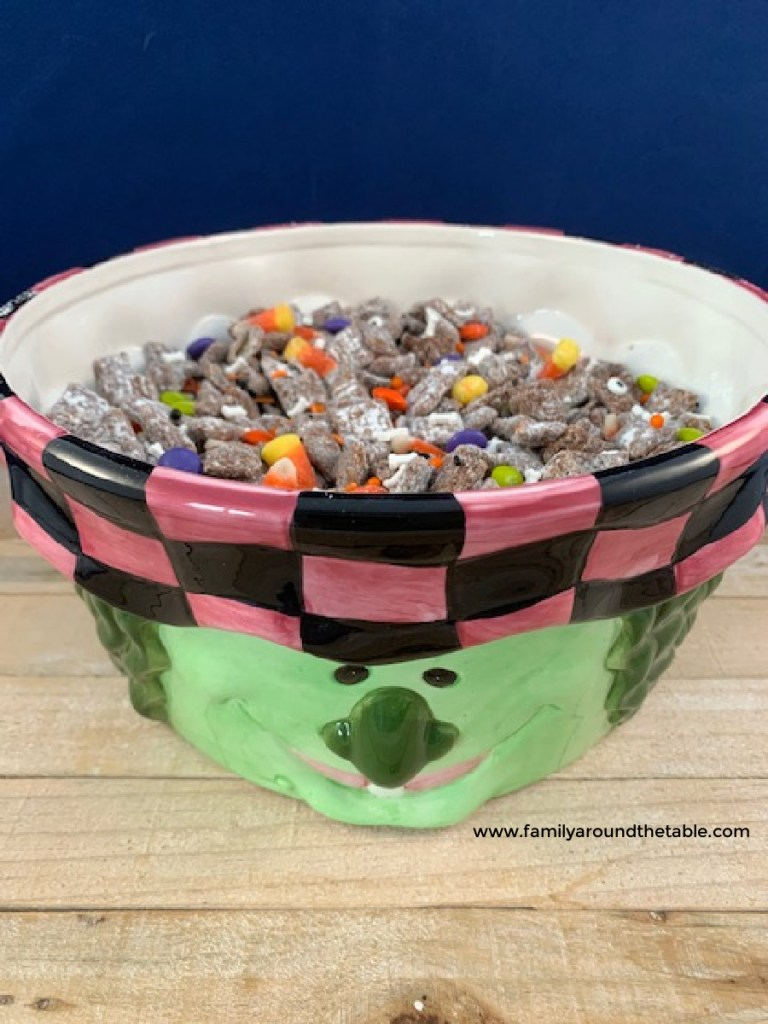 Halloween muddy buddies in a witch bowl.
