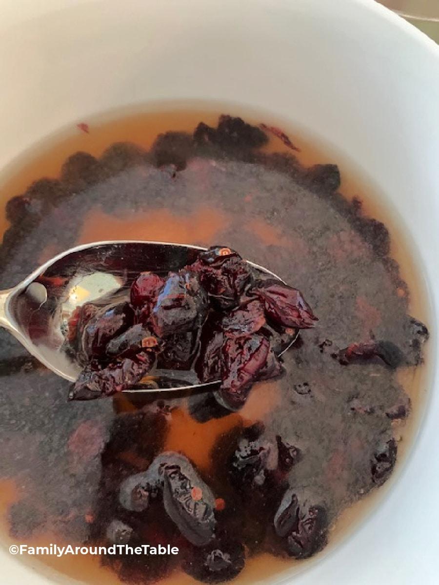 Reconstituted cranberries in apple cider tea.