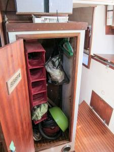 standing-locker-between-galley-and-companionway 2041