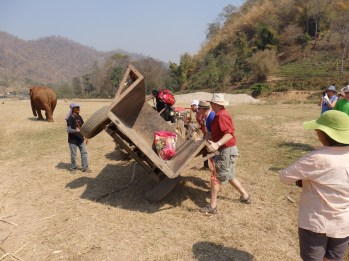 Tipping trailer back over after an elephant tipped it.