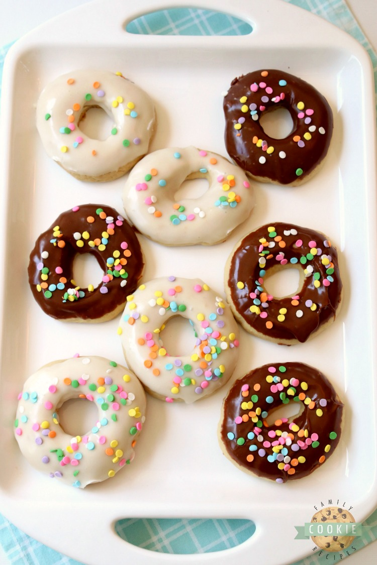 Glazed Donut Cookies are soft & pillowy donut-shaped cookies with a lovely chocolate or vanilla glaze & topped with sprinkles! Everything you love about donuts, only in cookie form!