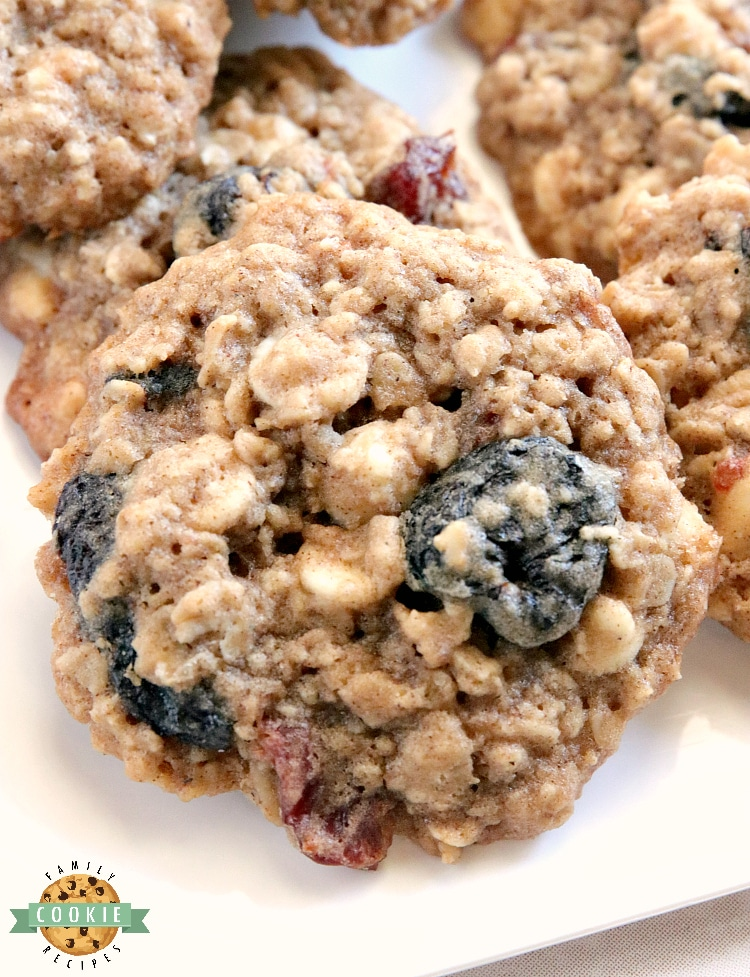 White Chocolate Cherry Oatmeal Cookies are made by adding white chocolate chips and dried cherries to the most amazing oatmeal cookie recipe ever! These cookies are soft and chewy and the flavors are incredible.