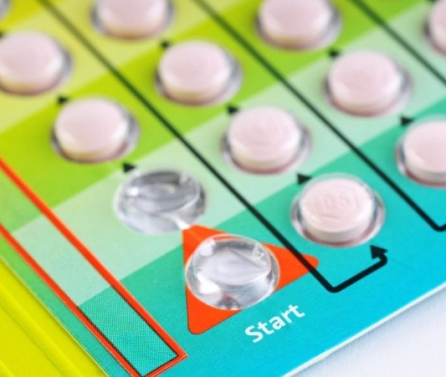 A Colorful Punch Out Sheet Of Birth Control Pills With The Word Start