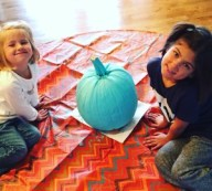 Grace and her sister participating in the Teal Pumpkin Project for children with allergies.
