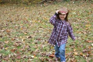 little girl in farmer clothes