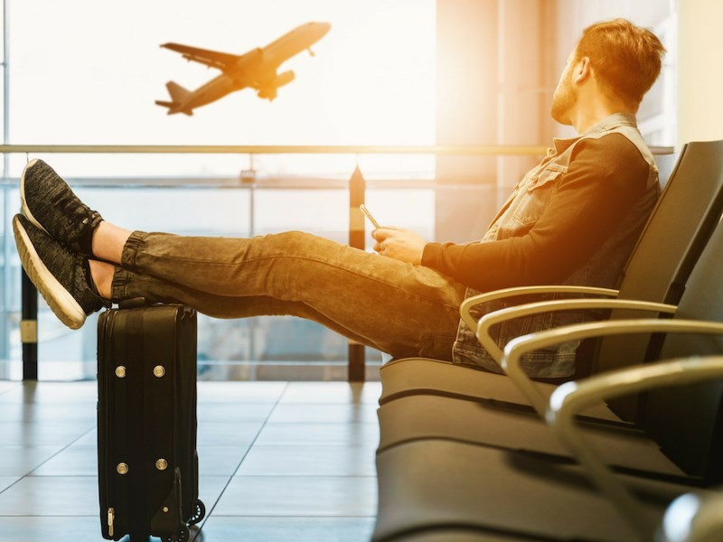 man looking out to aeroplane airport
