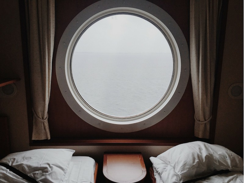 Porthole cruise liner twin beds