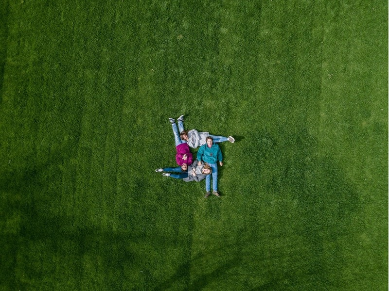 Aerial family shot on big green lawn