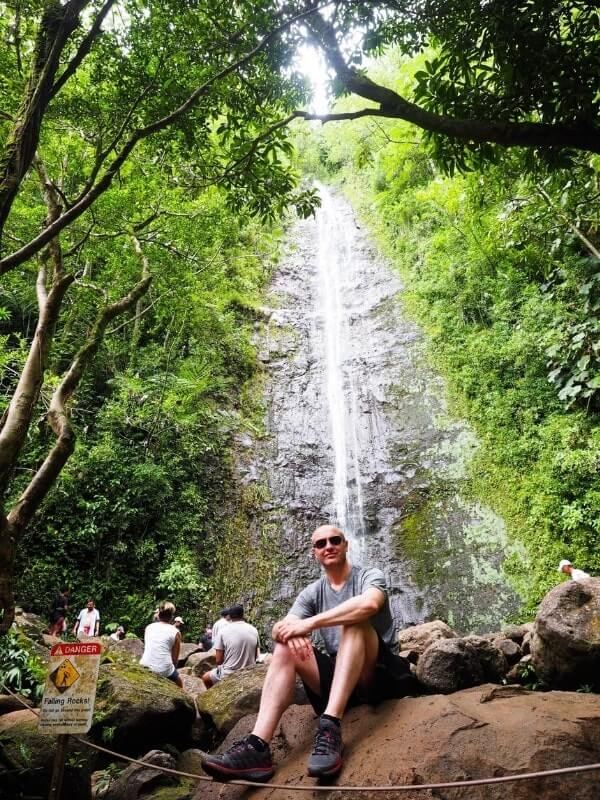 Manoa Falls man sitting on rock