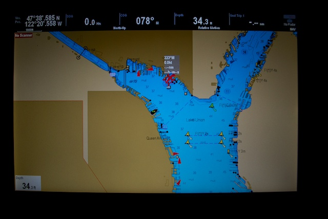 It also integrates information with our navigation instruments. In this example, the AIS is placing all identified vessels on the map on our chart plotter (the little red triangles).