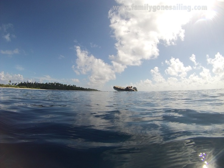 Drifting with the dinghy inside the pass