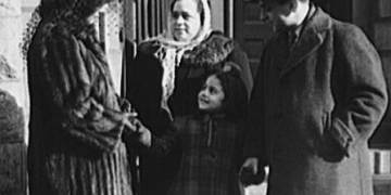 New York, New York. Italian family on the steps of a Catholic church in the Bronx after mass on Sunday