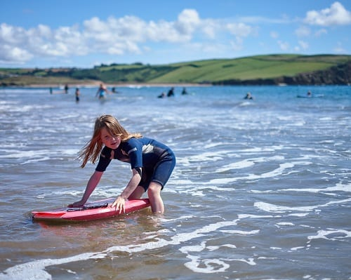 Young girl surfing in Devon