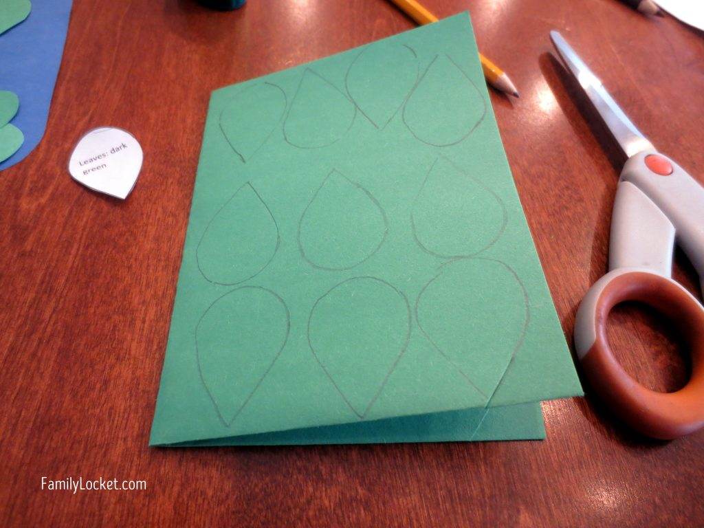 Cutting out leaves for family tree craft